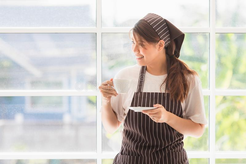 Asian women at kitchen room stock images