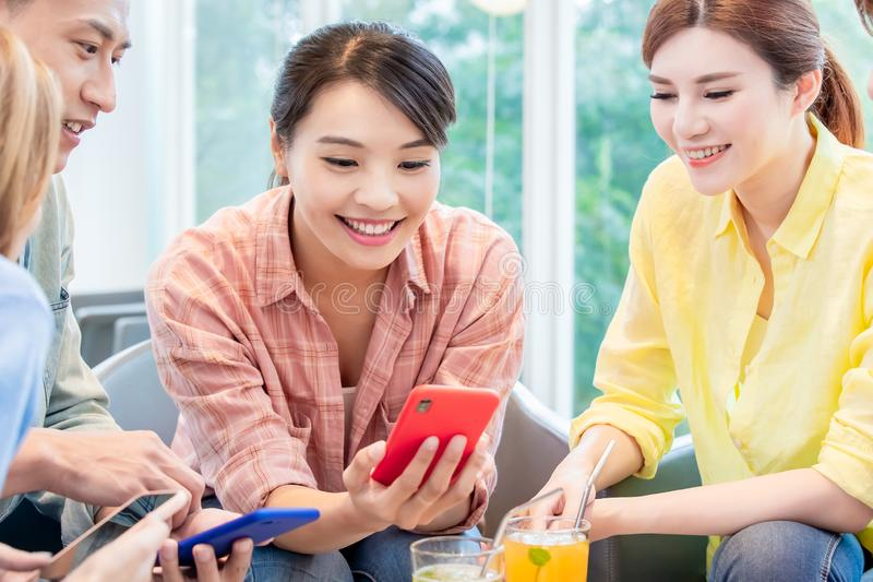 Asian friends use smart phone stock images
