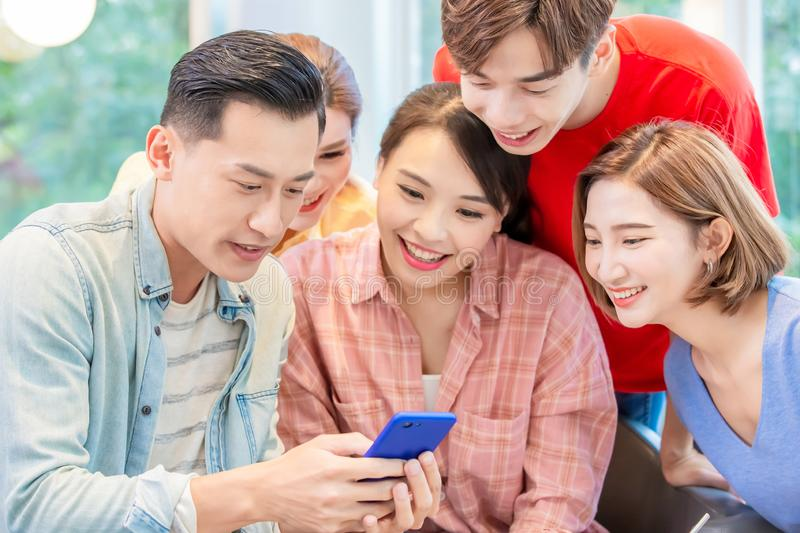 Friends watch smart phone stock photography
