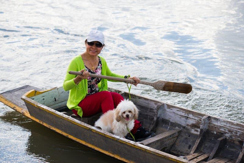 Asian women paddle boat on lake royalty free stock photo