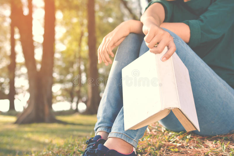 Asian women reading a book in nature stock images