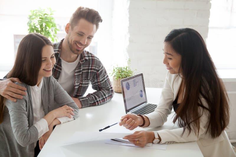 Asian realtor, insurance broker or financial advisor consulting stock photography
