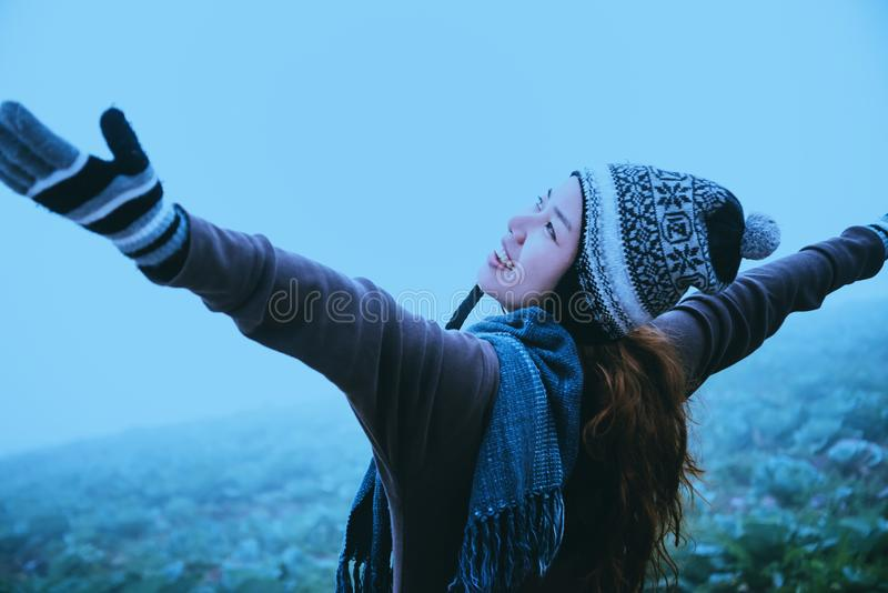 Asian women relax in the holiday. Happy to travel in the holiday. During the foggy winter. Asian woman relax in the holiday. Happy to travel in the holiday royalty free stock photo