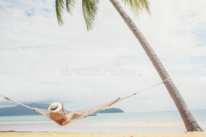 Asian women relaxing in hammock summer holiday on beach stock photos