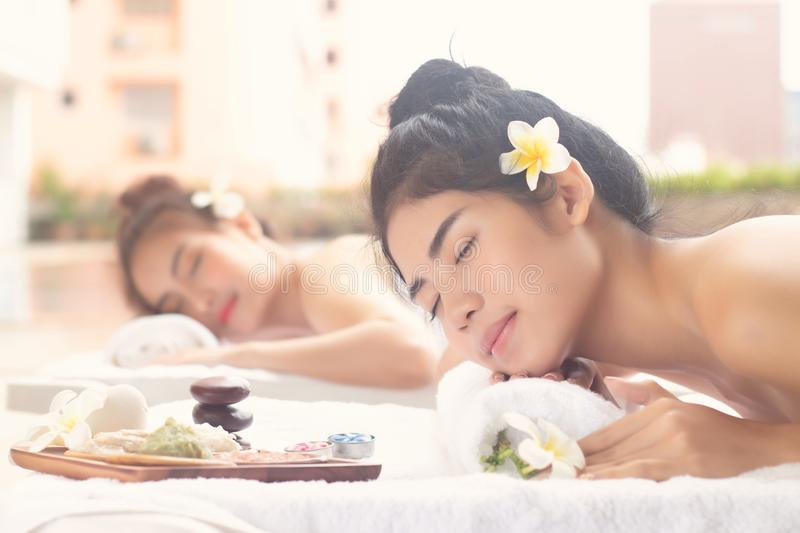 Asian Women Relaxing With Joyful Mood Together At The Edge Of Swimming Pool.Wellness Body Care And Spa Aromatherapy Concept stock image