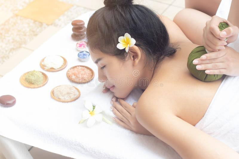 Asian women relaxing massage treatment with joyful mood together at the edge of swimming pool.Wellness body care and spa stock image