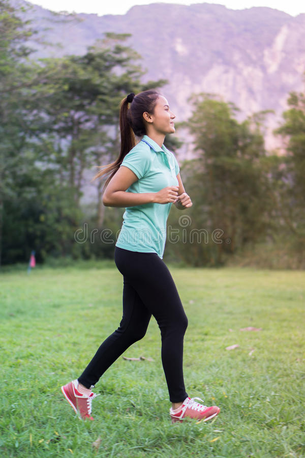 Asian women run out of fitness for health royalty free stock photos