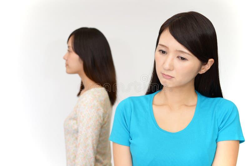 Uneasy Asian women stock image