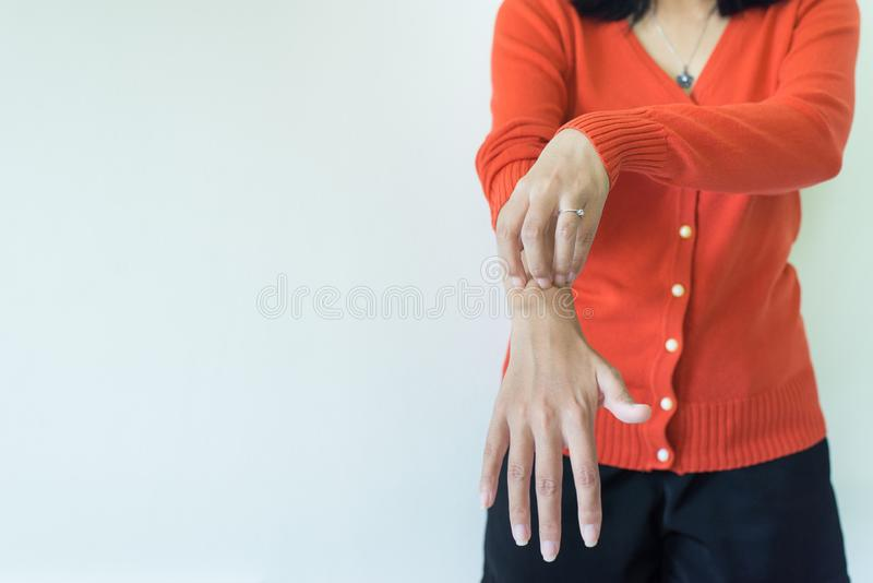 Asian woman scratch itch with her arm,Itching and scratching,Copy space on white blackground. Asian women scratch itch with her arm,Itching and scratching,Copy stock image
