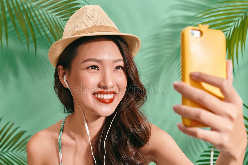 Asian women selfie herself on blue backgound. Asian women happy for travel on summer. Asian woman selfie herself on blue backgound. Asian woman happy for travel royalty free stock photos