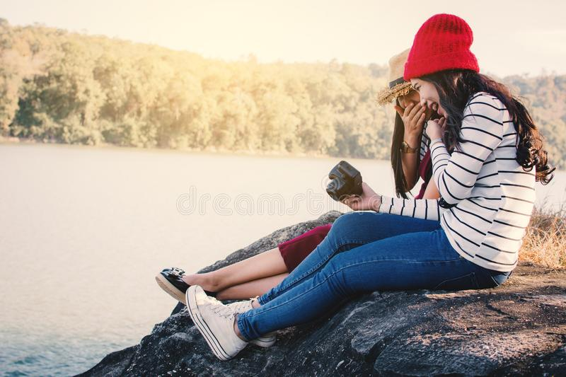Asian women shooting picture in nature stock images