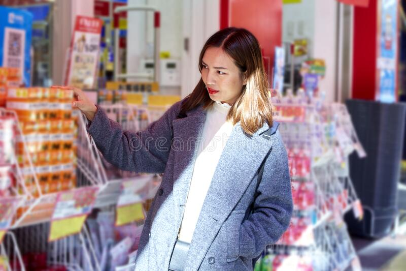 Asian Women shopping at the supermarket stock photos
