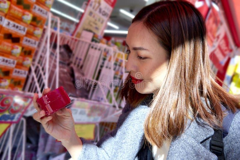 Asian Women shopping at the supermarket royalty free stock photos