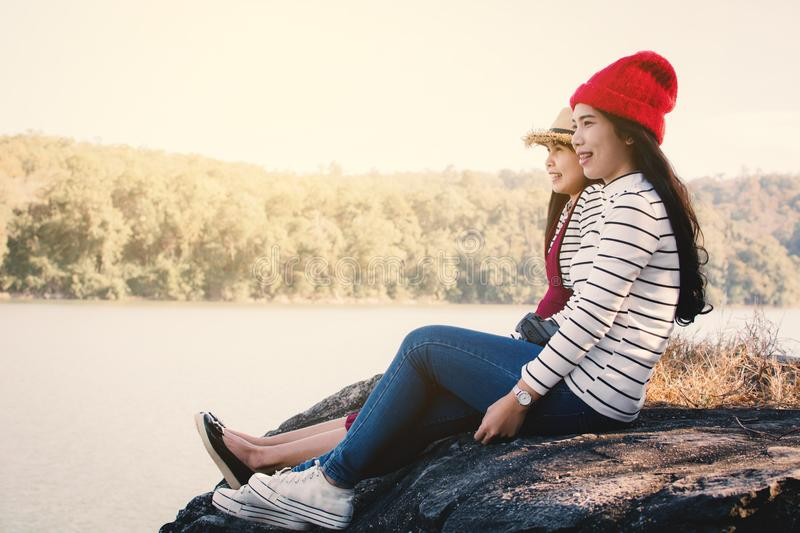 Asian women sitting on rock in nature royalty free stock photo