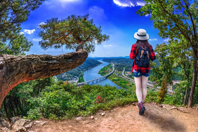 Asian women standing on the observation deck With the river as the line of sight at Kongju, South Korea.  stock photo