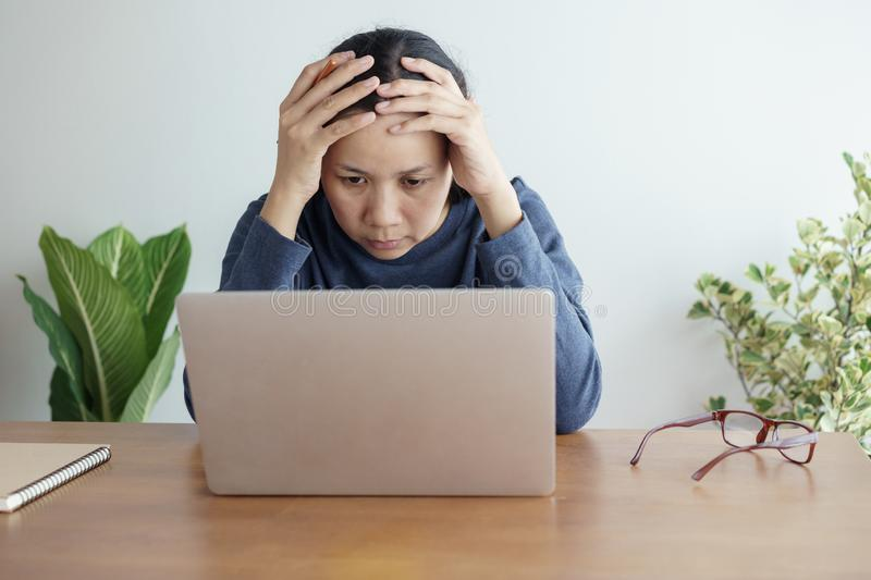 Asian women stressful working with  computer for a long time, Office syndrome concept. Asian woman stressful working with a computer for a long time, Office stock images