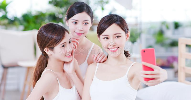 Asian women take selfie happily royalty free stock photography