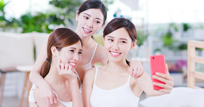 Asian women take selfie happily royalty free stock photos