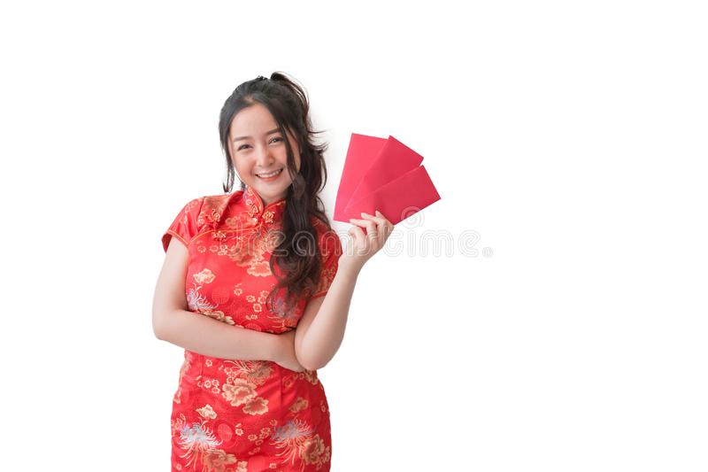 Asian women in traditional Chinese cheongsam dresses and showing red envelopes for chinese new year stock image