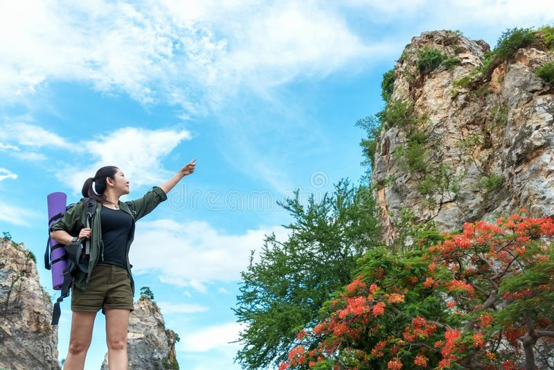 Asian Women Traveler or hiking with backpack mountaineering lake and mountains on background Summer expedition vacations outdoor. Travel Lifestyle concept royalty free stock images