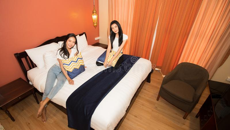 Asian Women Travelers enjoy travel and check in stock photography