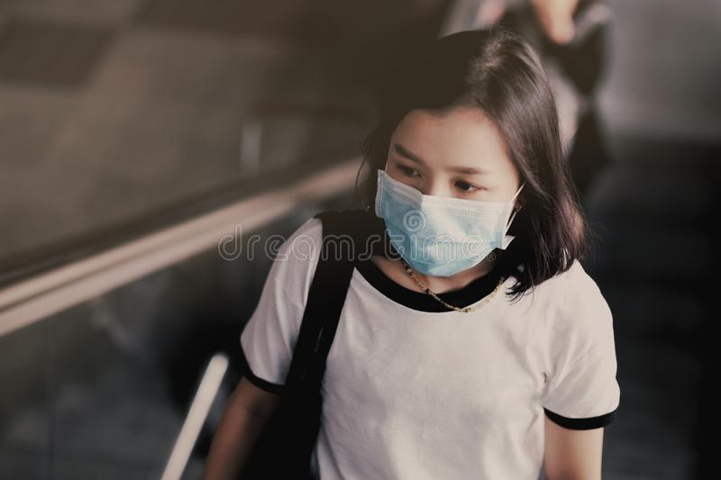 Asian women wear masks to protect The PM 25 pollution. Asian woman wear masks to protect The PM 25 pollution, air, woman, sick, face, people, smog, environment stock images