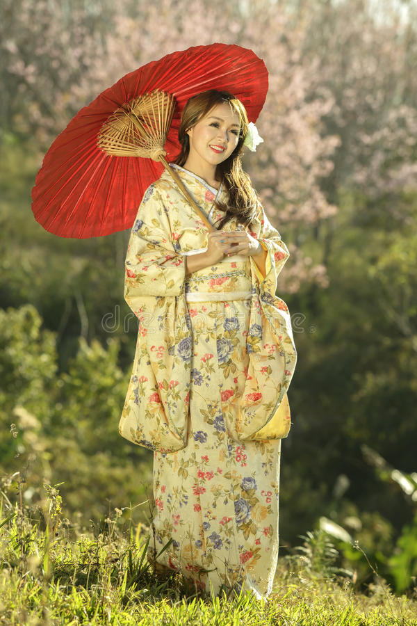 Asian women wearing traditional japanese kimono and red umbrella royalty free stock photos