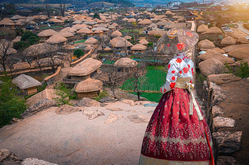Asian women wearing traditional Korean clothes Hanbok visit an ancient village in the south of South Korea stock photography