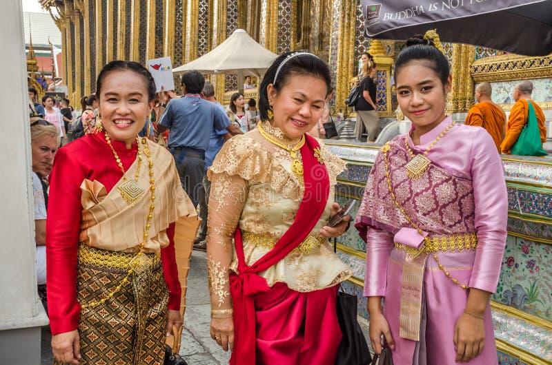 Asian women wearing typical traditional Thai dress, Bangkok royalty free stock image