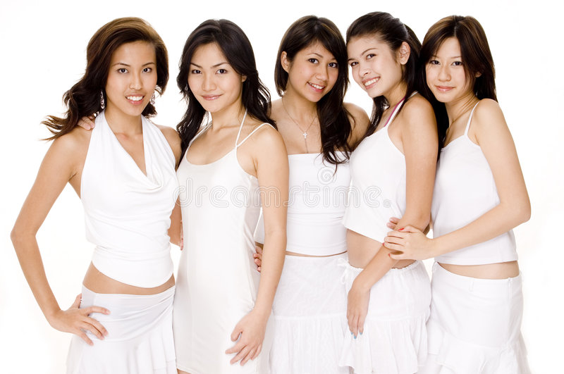 Asian Women In White #1. Five beautiful asian women in white on white royalty free stock images
