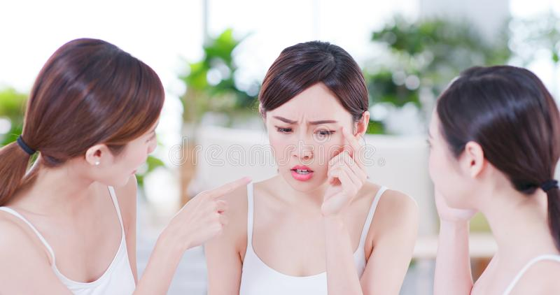 Asian women worry her skin stock photography