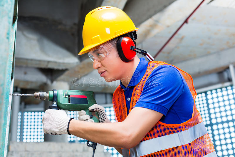 Download Asian Worker Drilling In Construction Site Wall Stock Image - Image: 37544481