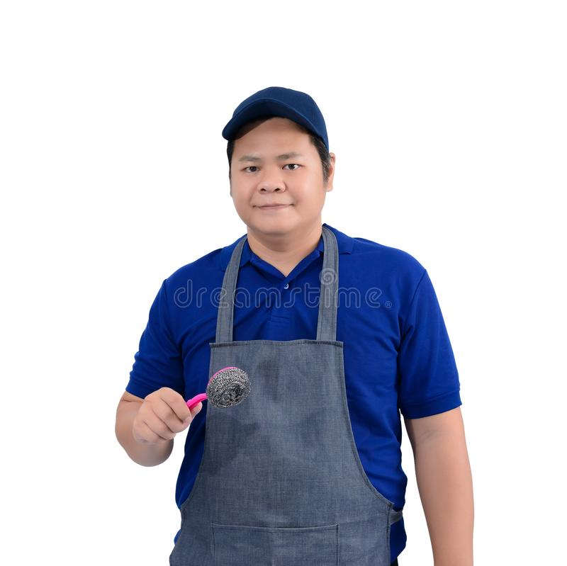 Asian worker man in blue shirt with apron and protective gloves hand holding Scrub brush isolated on white stock images