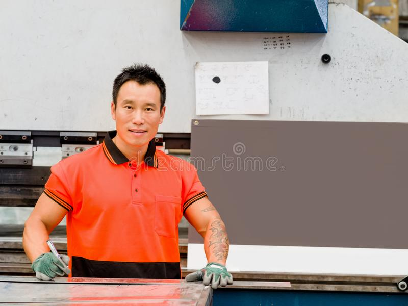 Asian worker in production plant on the factory floor. Portrait of asian worker in production plant working on the factory floor royalty free stock image