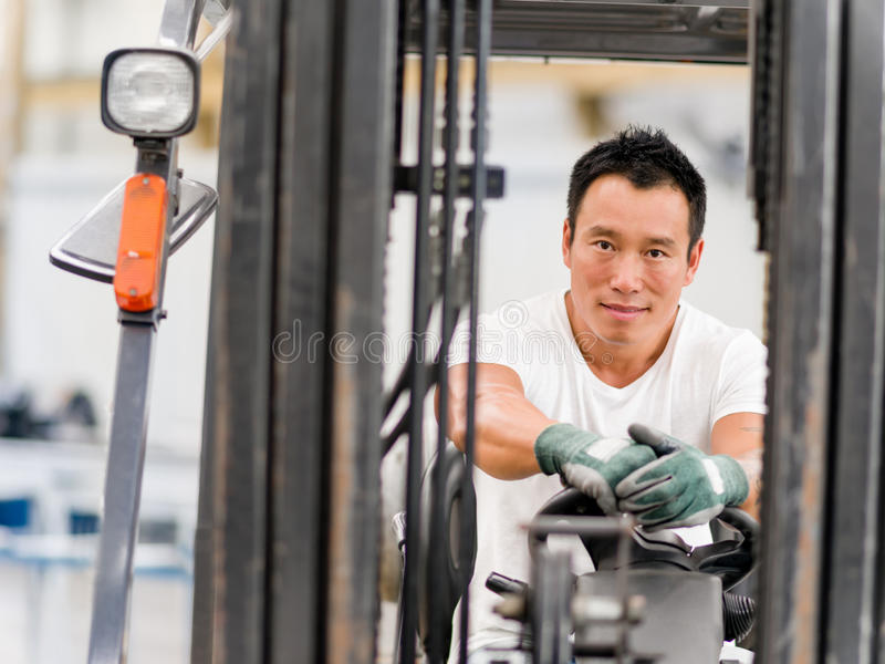 Asian worker in production plant on the factory floor. Portrait of asian worker in production plant working on the factory floor stock photos