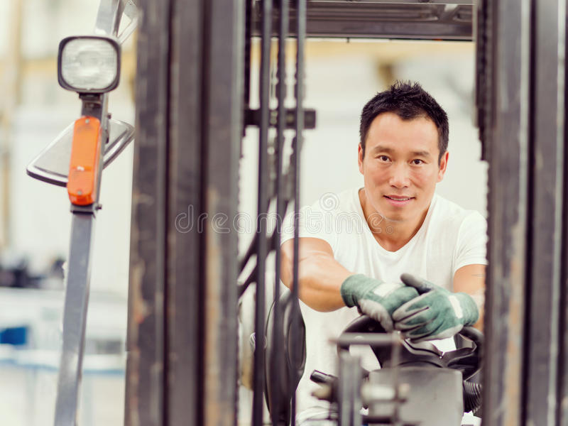 Asian worker in production plant on the factory. Portrait of asian worker in production plant working on the factory floor royalty free stock photo