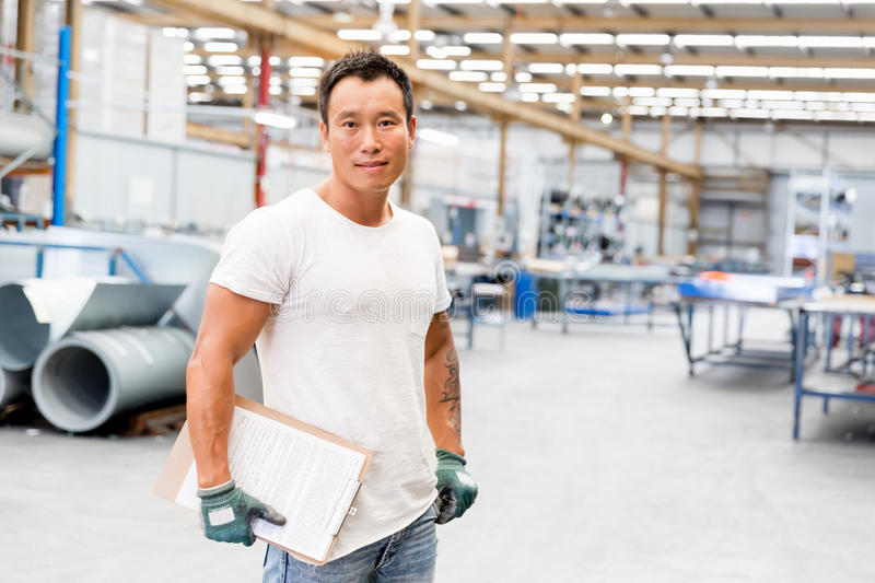 Asian worker in production plant on the factory stock photography
