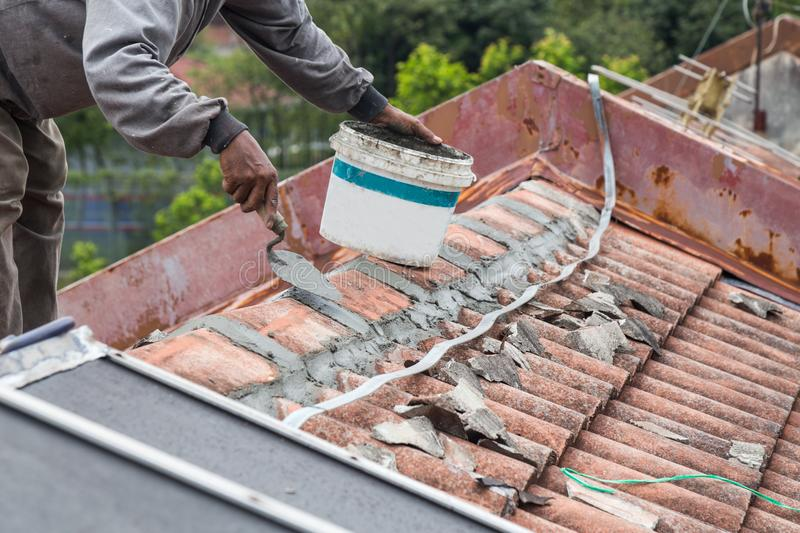Asian worker secure roof tiles with cement on old building stock download asian worker secure roof tiles with cement on old building stock photo image of ppazfo
