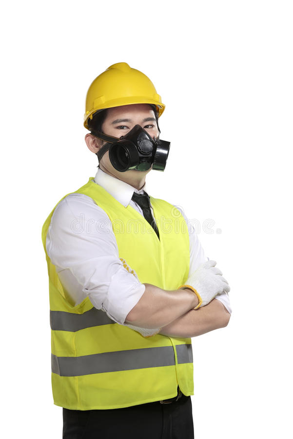 Asian worker wearing safety vest and yellow helmet. Isolated over white background royalty free stock photos
