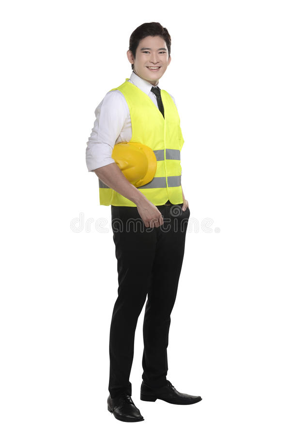 Asian worker wearing safety vest and yellow helmet. Isolated over white background royalty free stock image