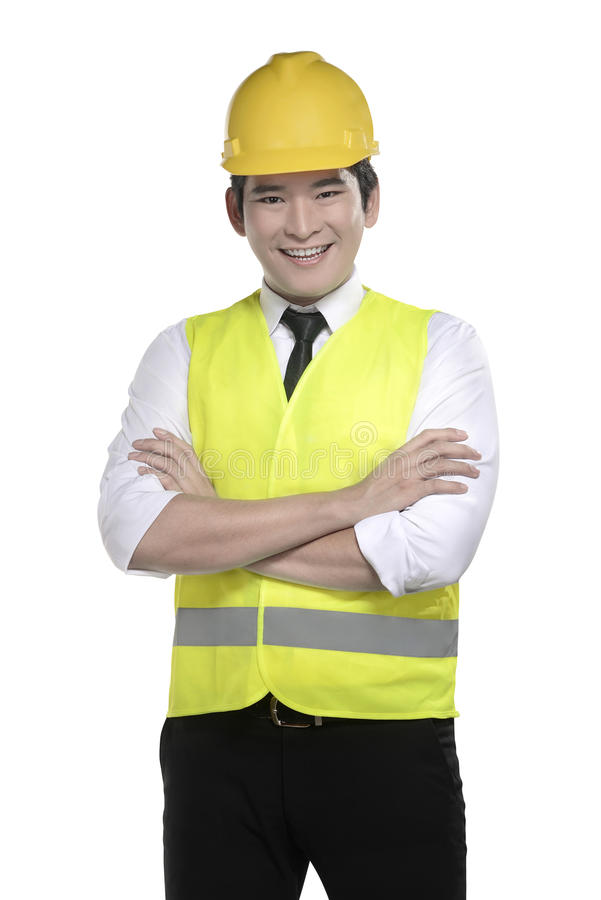 Asian worker wearing safety vest and yellow helmet. Isolated over white background stock photos