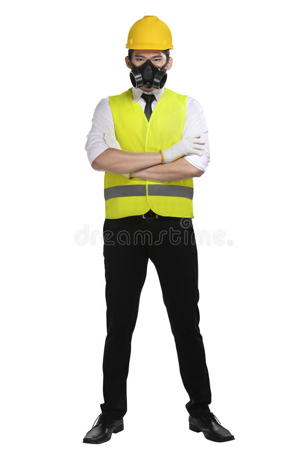 Asian worker wearing safety vest and yellow helmet. Isolated over white background stock photography