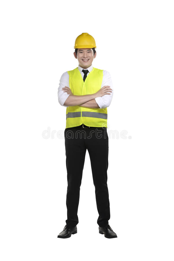 Asian worker wearing safety vest and yellow helmet. Isolated over white background royalty free stock images