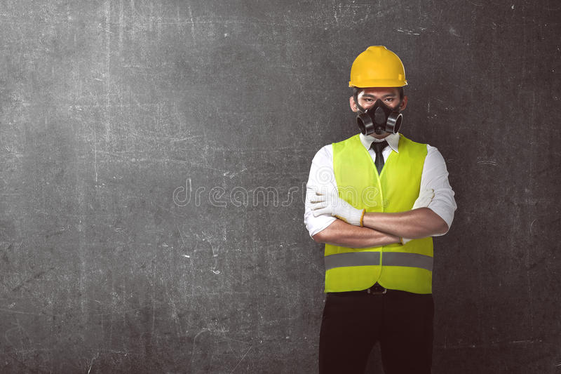 Asian worker wearing safety vest and yellow helmet. Over grunge background stock photo