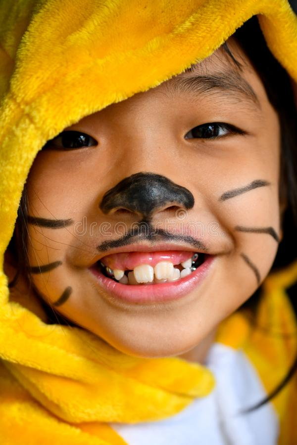 Asian yellow teen funny face fashion royalty free stock image