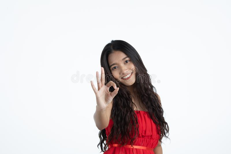 Asian young beautiful lady in red dress stock photo