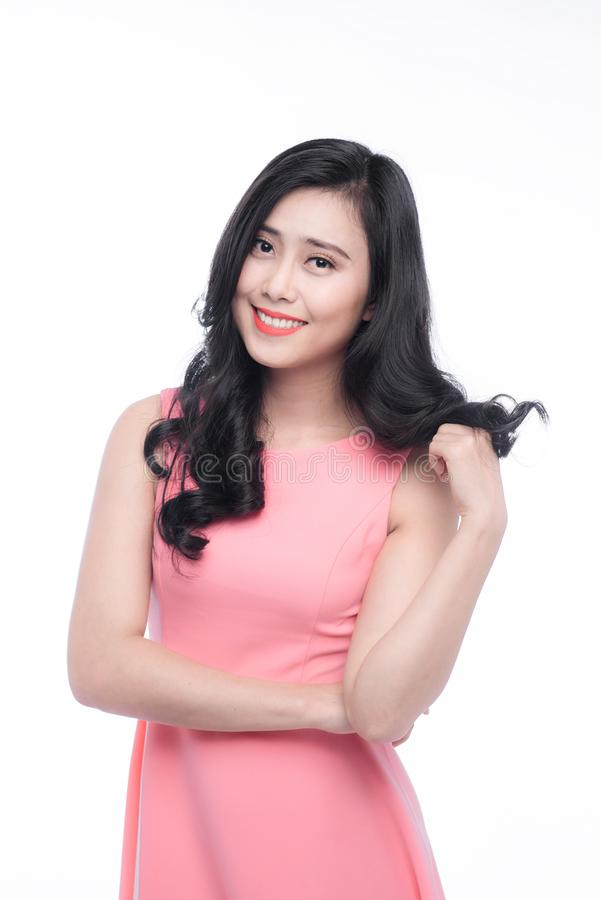 Asian young beautiful woman with long black hair in pink dress s stock photos