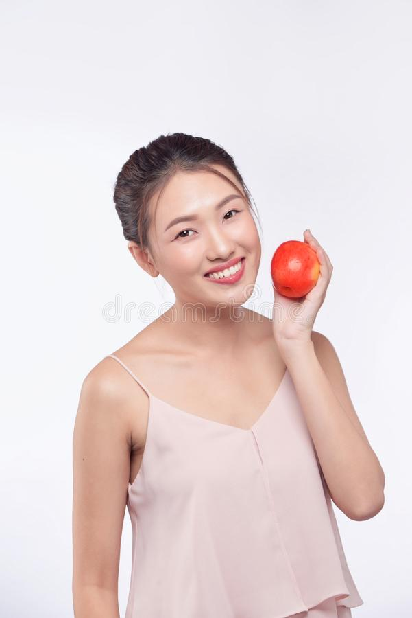 Asian young beautiful woman smile and hold apple on her hand.  royalty free stock photo
