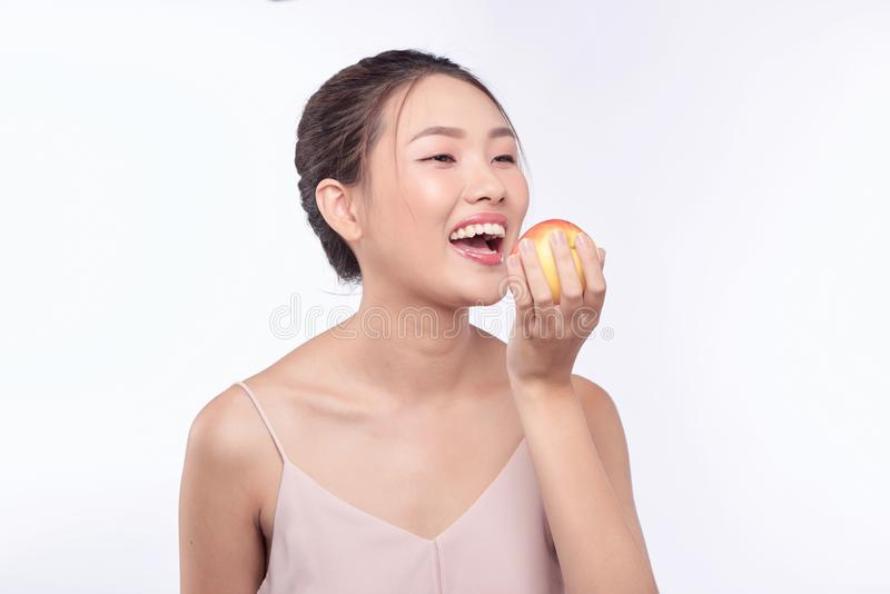 Asian young beautiful woman smile and hold apple on her hand.  stock image