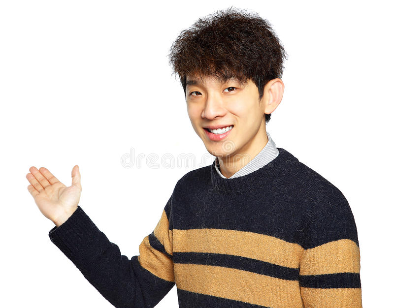 Asian young business man hold show open empty palm. Happy smile, concept of advertisement product, empty copy space wear sweaters isolated over white stock photography